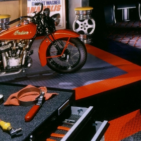 Garage with a classic Indian motorcycle and RaceDeck Garage Flooring