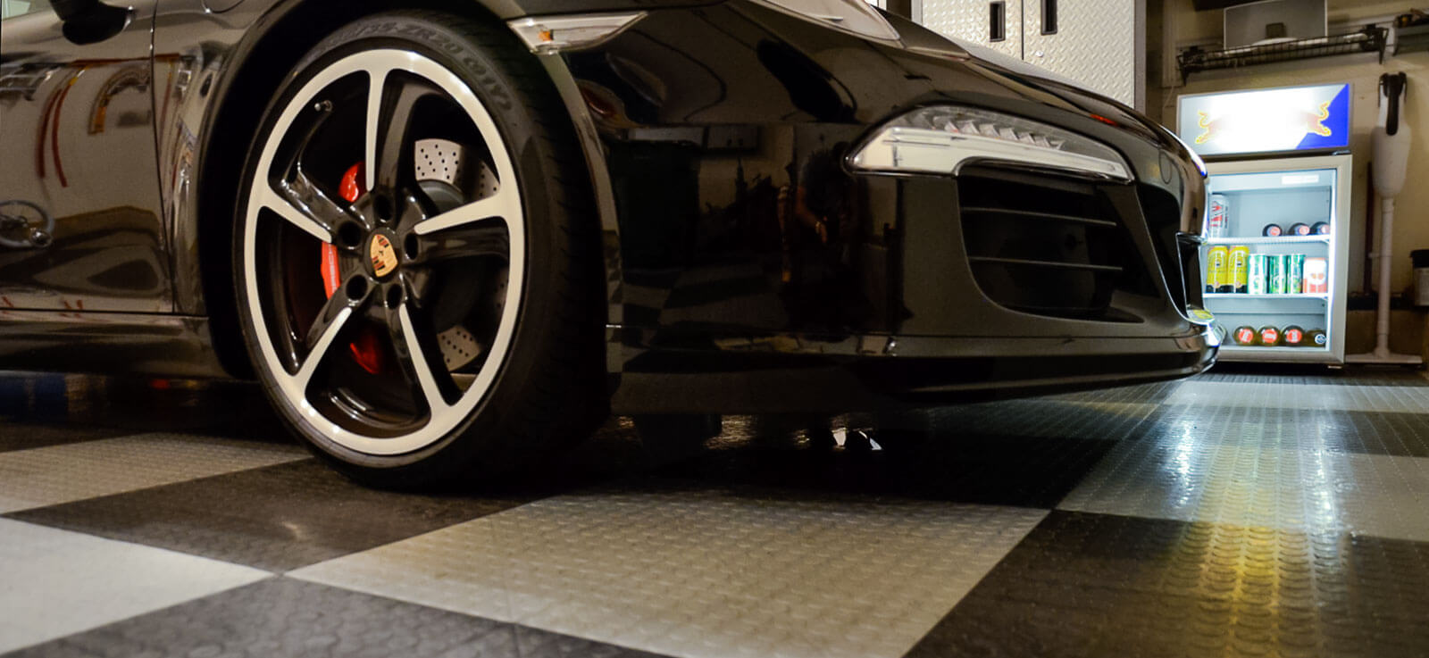 A Porsche on CircleTrac garage flooring