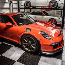 Three Porsches on RaceDeck Diamond garage flooring with TuffShield