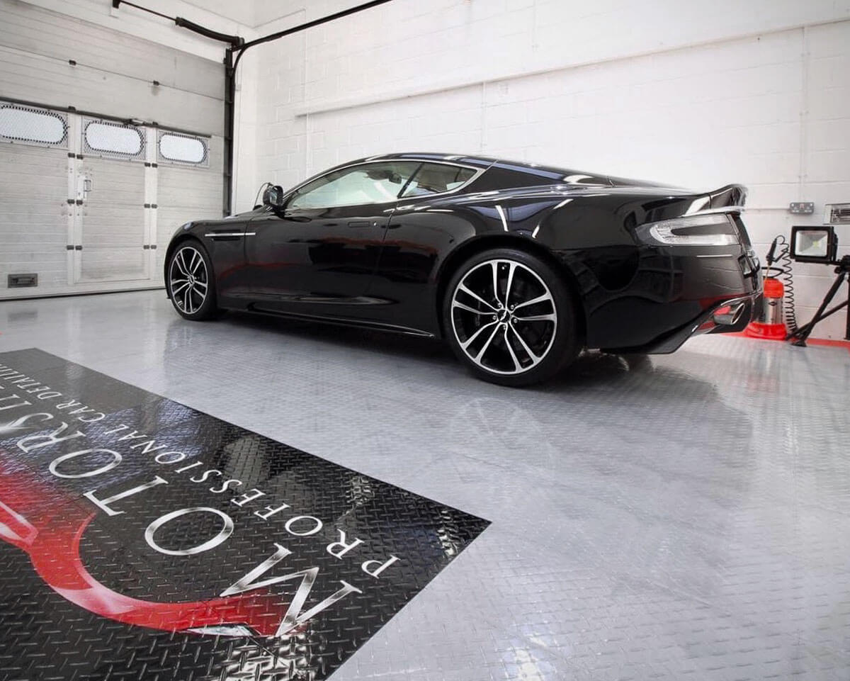 Aston Martin on a Diamond TuffShield® garage floor with a custom logo
