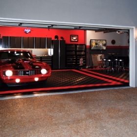 Camaro SS in a three car garage with Free-Flow flooring