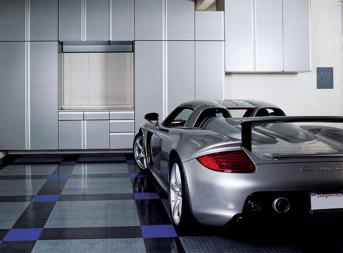 A garage with a Carrera GT and RaceDeck