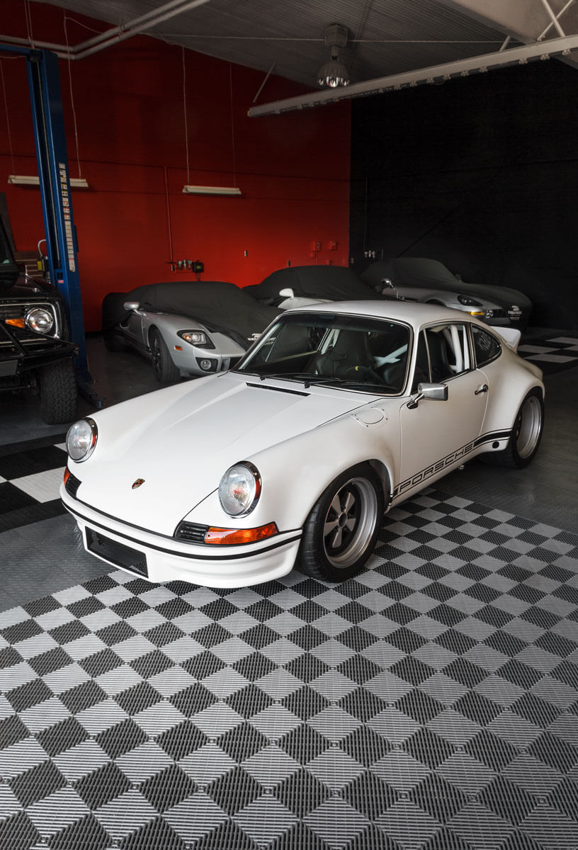 A classic Porsche parked on RaceDeck garage flooring