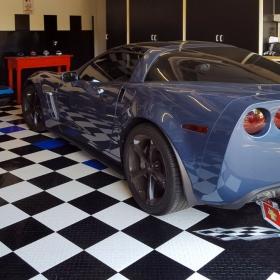 A Corvette on RaceDeck Diamond with Tuffshield® and a custom logo