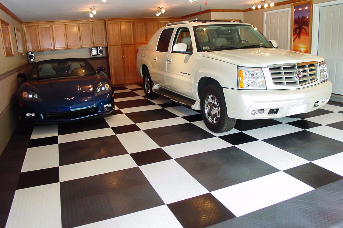 A Corvette and an Escalade on a RaceDeck XL garage floor