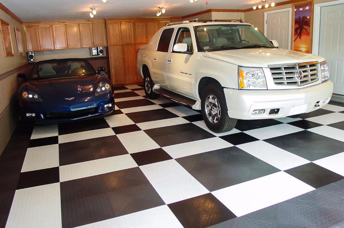 A Corvette and an Escalade on a RaceDeck XL garage floor