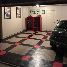 A home garage at night with a Fiat 500 and CircleTrac