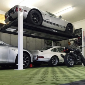 A Ford GT, a Porsche, a BMW, and a Ducati all in one garage with RaceDeck Free-Flow