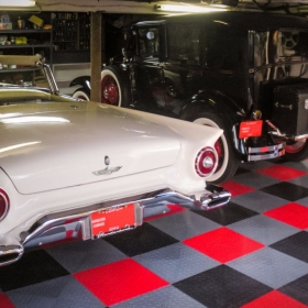 A garage with a Ford Thunderbird and RaceDeck XL