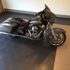 A Harley-Davidson on a CircleTrac garage floor