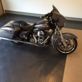 A Harley-Davidson on a CircleTrac garage floor