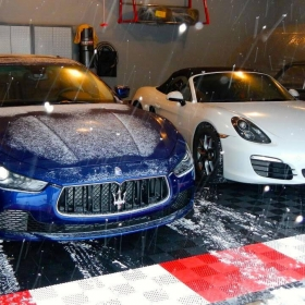 Free-Flow's maximum and drainage of liquids will help keep this garage dry from a snow covered Maserati