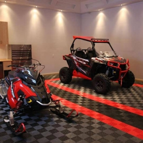 Snowmobile and side-by-side on Free-Flow garage flooring