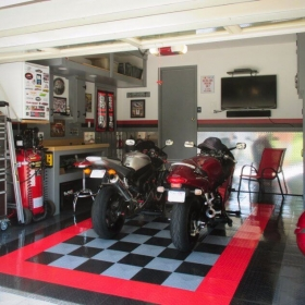 A home garage with Two sportbikes on RaceDeck diamond™ with Tuffshield®