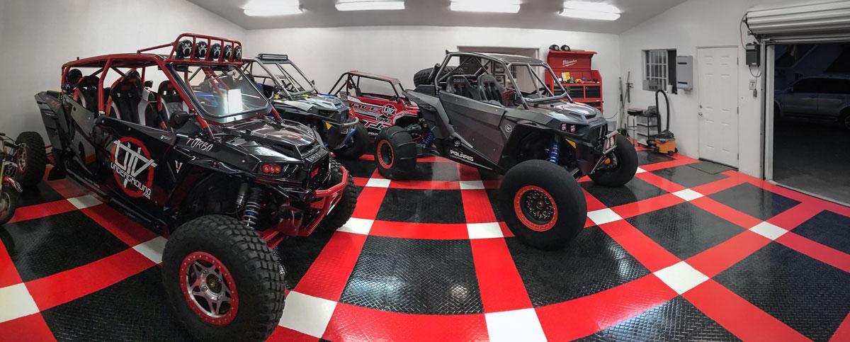UTVs parked on RaceDeck Diamond with TuffShield®