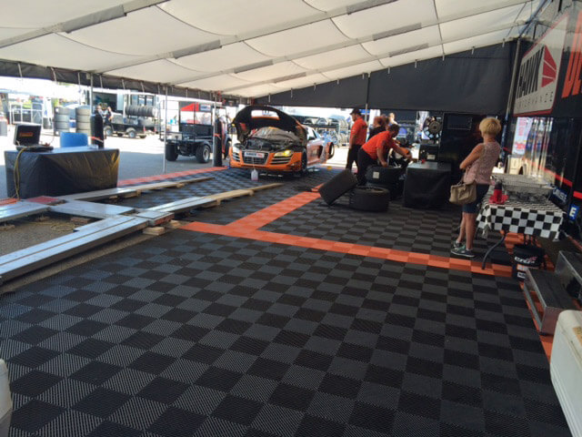 RaceDeck Free-Flow XL flooring for a racing paddock