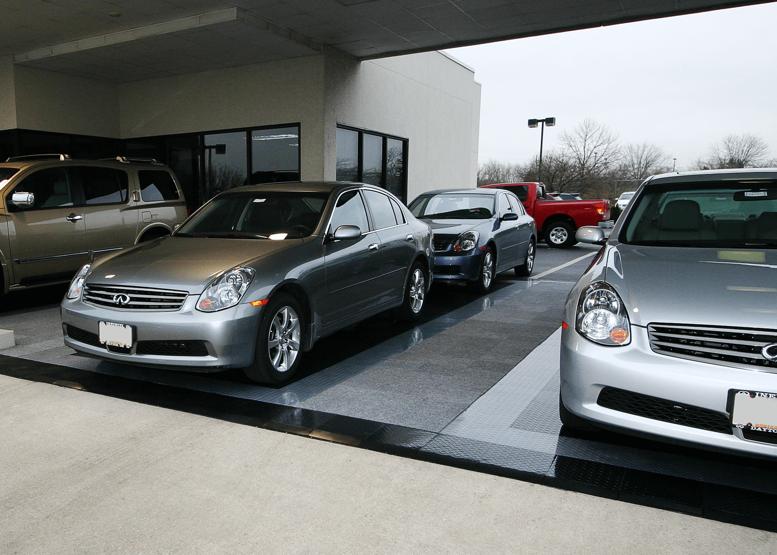 Infiniti delivery bays with RaceDeck Diamond and Snap-Carpet flooring.