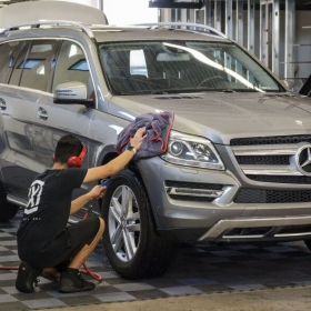 Mercedes Benz being dried off at an auto spa
