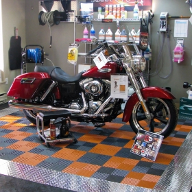 Motorcycle retail pop display with RaceDeck Pro and Free-Flow flooring.