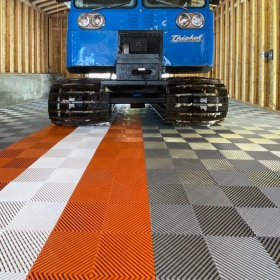 Thiokol Spryte Snowcat parked on Free-Flow XLC commercial-grade garage tiles