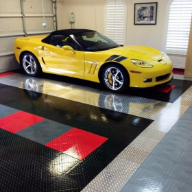 A yellow Corvette in a garage with RaceDeck Pro accents