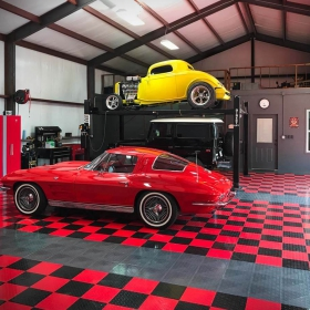 Huge garage with a 63 Corvette coupe.
