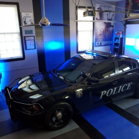 Police themed garage matches the flooring and wall design perfectly