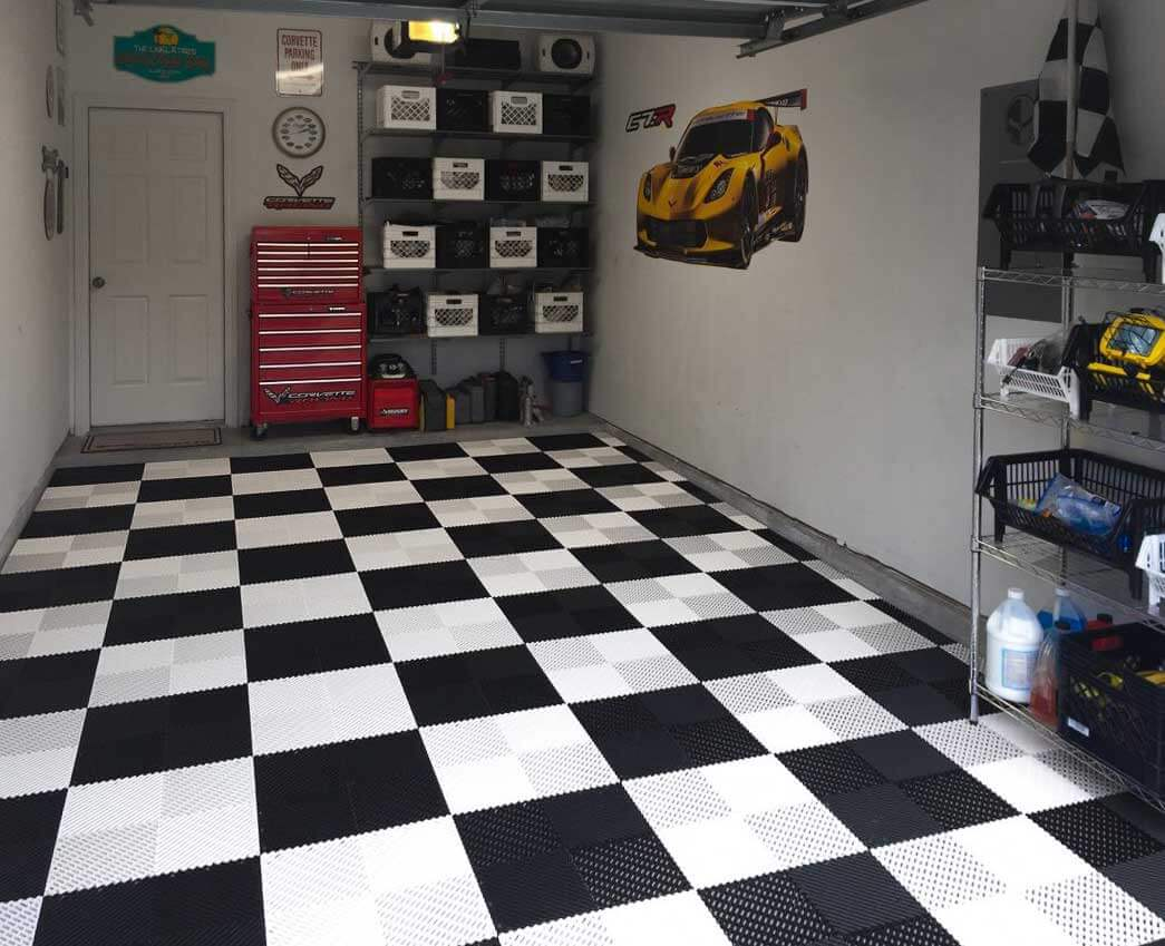 Corvette-themed garage with checkered Free-Flow XL