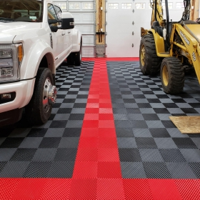 New commercial grade Free-Flow XLC in a garage with trucks and heavy equipment.