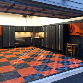Black and orange garage with matching Free-Flow flooring and edges.
