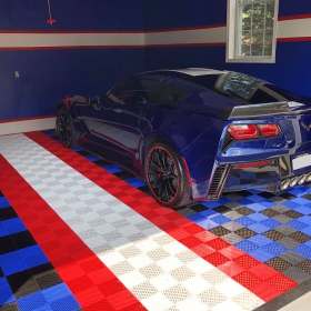 Corvette in a matching blue, red, white and black garage with Free-Flow flooring.