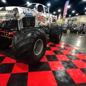 Monster truck on RaceDeck Diamond flooring at Autorama