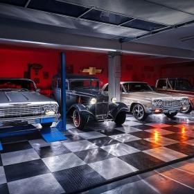 Multi-car garage with lit cars on RaceDeck Diamond flooring