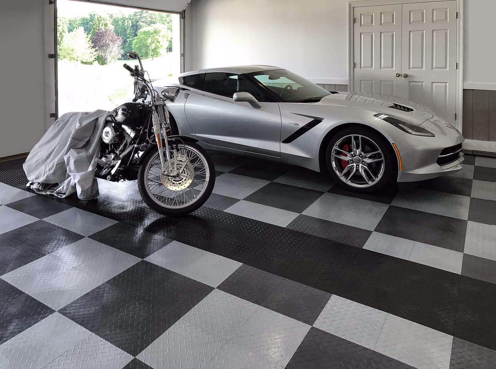 Home garage with a Corvette and motorcycle parked on RaceDeck Diamond.