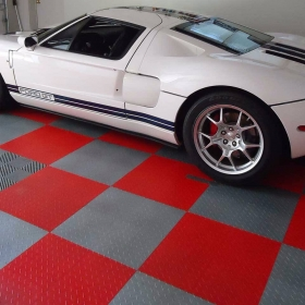 White Ford GT in a RaceDeck Diamond garage floors with Free-Flow over a drain.