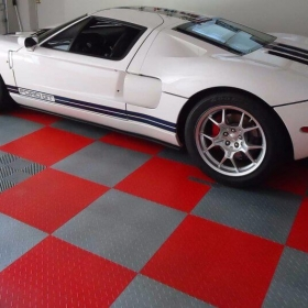White Ford GT in a RaceDeck Diamond garage with Free-Flow over a drain.