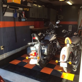 Two Motorcycles on RaceDeck Diamond in Orange, Alloy and Black