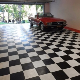 Mercedes in a checkered RaceDeck Diamond garage