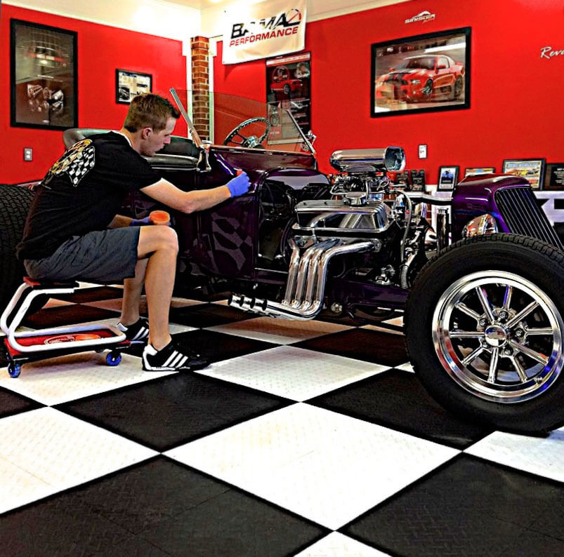 Working on a hot rod parked on RaceDeck Diamond