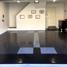 Home garage with Diamond TuffShield flooring in black, graphite and alloy