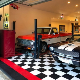 Black, white and red RaceDeck Diamond garage with 2 cars and lift