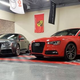 Two Audis on a custom RaceDeck Free-Flow parking pad