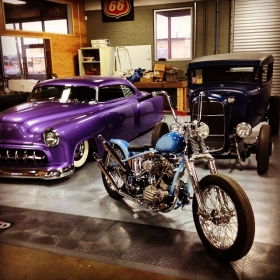Austin speed shop garage floor with a Shovelhead, a '54 Chevy Custom, and a '32 coupe