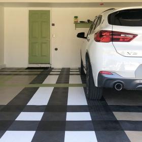 BMW X2 on RaceDeck Diamond in black, white, graphite, beige, and green light.