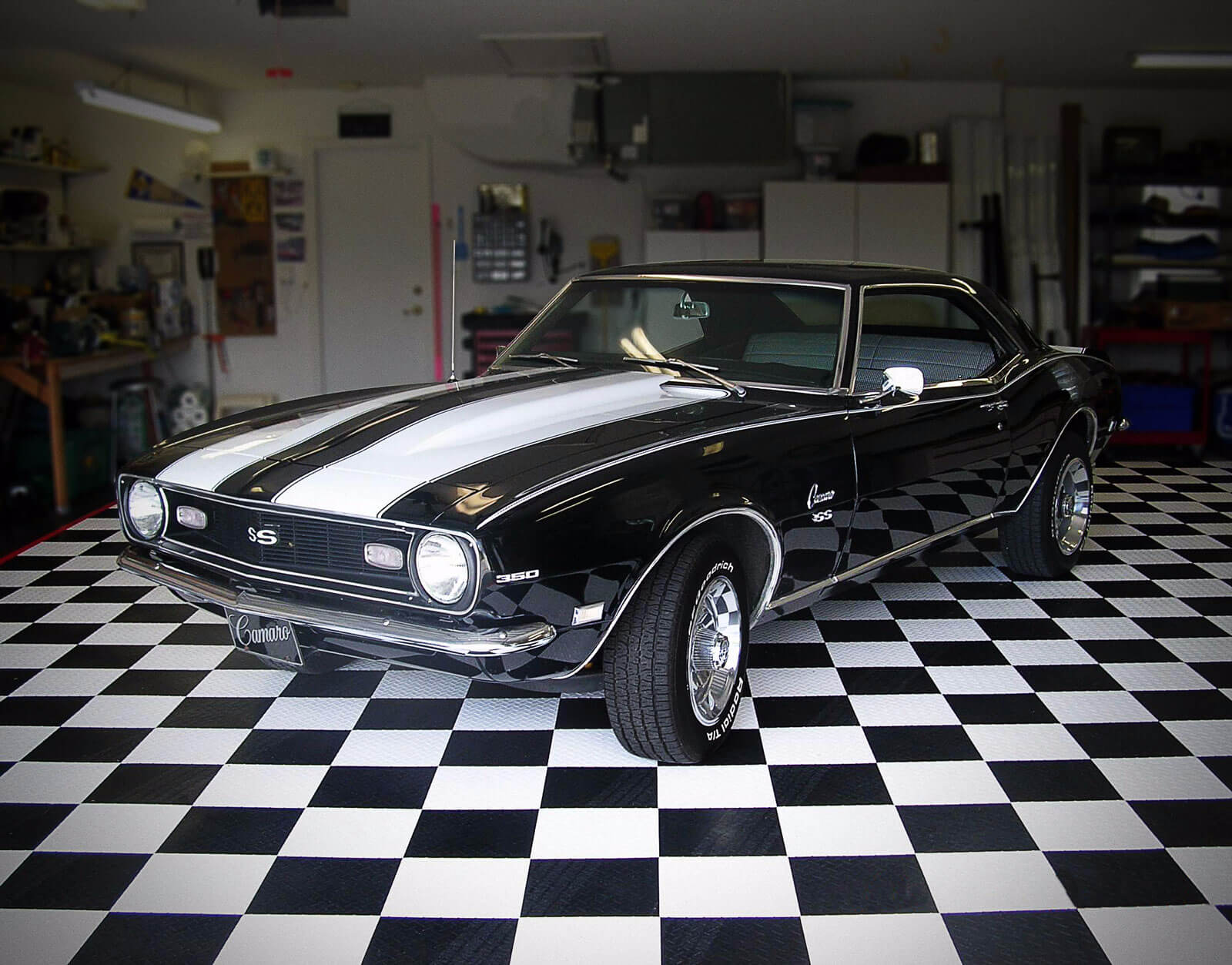 Camaro SS on a checkerboard floor with black and white RaceDeck
