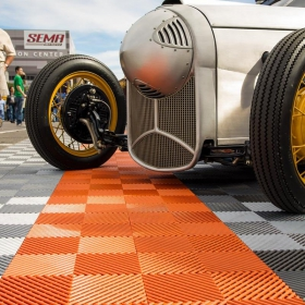 Orange and grey interlocking garage floor tiles
