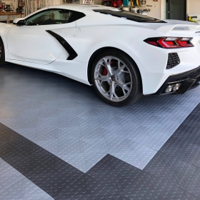 CircleTrac garage in alloy and graphite colors with white Corvette