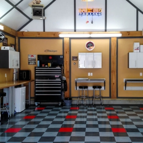 A clean garage in RaceDeck Diamond garage flooring tile with TuffShield®
