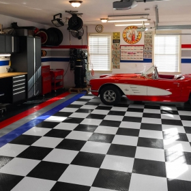 Corvette on a checkerboard garage tile floor