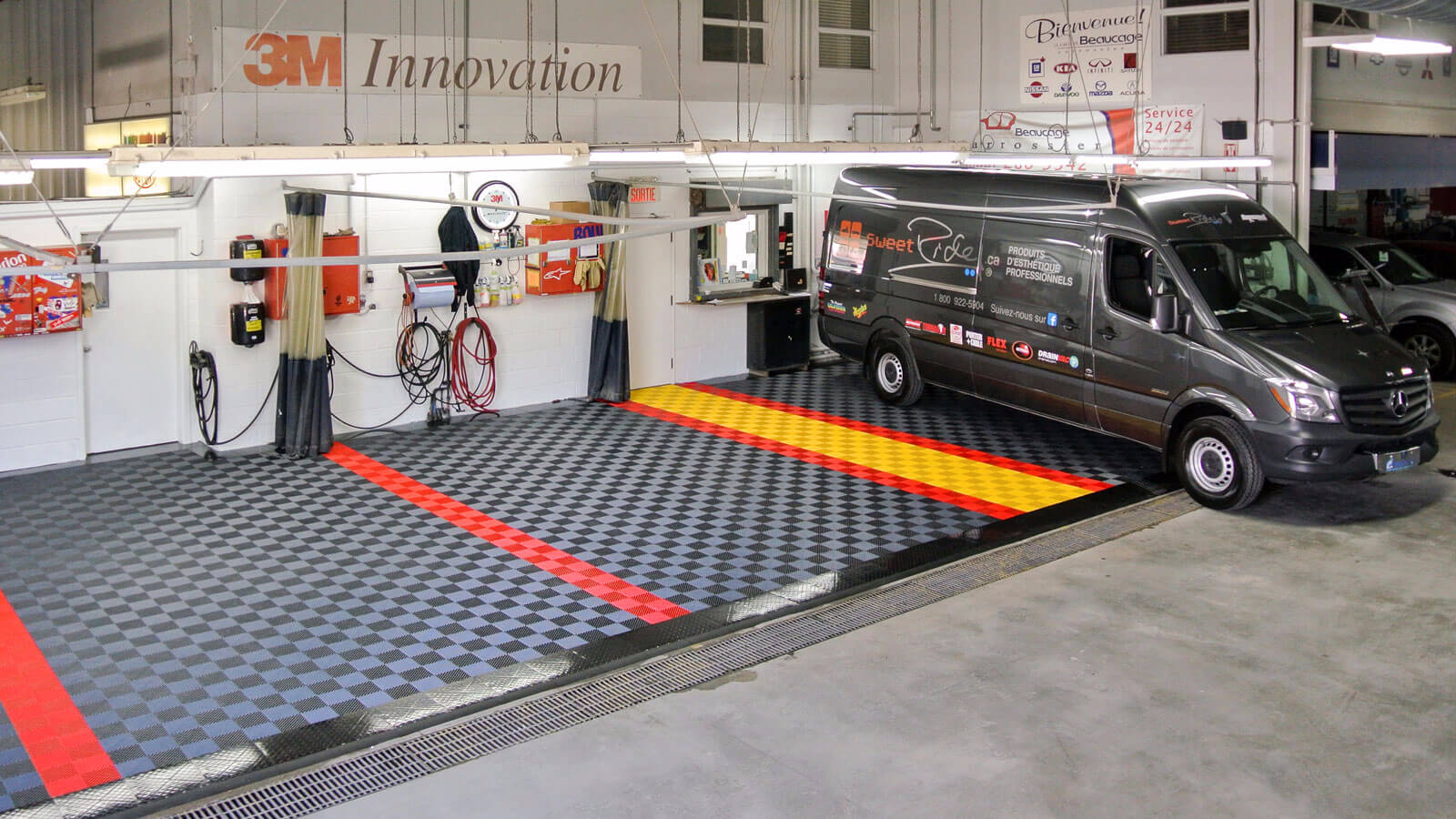 Detailing bay with self-draining Free-Flow shop flooring